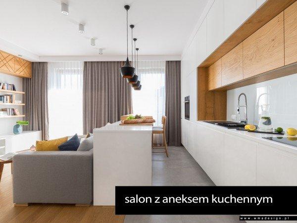 <span>salon z aneksem kuchennym</span><i>→</i>